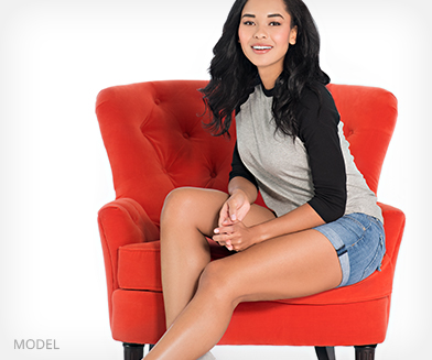girl with nice legs sitting on red chair