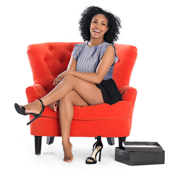 Model on red chair